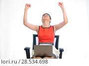 Купить «Short hair business woman on a laptop sitting in an office chair», фото № 28534698, снято 11 сентября 2011 г. (c) Ingram Publishing / Фотобанк Лори
