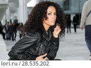 Купить «Black female, afro hairstyle, in urban background. Woman wearing denim jear shorts and leather jacket.», фото № 28535202, снято 11 декабря 2011 г. (c) Ingram Publishing / Фотобанк Лори