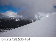 Купить «Scenic view of snow covered mountains against cloudy sky, Whistler, British Columbia, Canada», фото № 28535454, снято 25 марта 2016 г. (c) Ingram Publishing / Фотобанк Лори