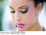 Купить «Portrait of a young black woman, model of fashion, with fantasy make up made by a professional beautician», фото № 28535758, снято 16 сентября 2012 г. (c) Ingram Publishing / Фотобанк Лори