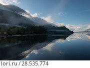 Купить «Reflection of trees in water, Furry Creek, British Columbia, Canada», фото № 28535774, снято 22 марта 2016 г. (c) Ingram Publishing / Фотобанк Лори