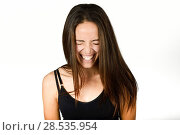 Купить «Beautiful young woman without make-up laughing. Beautiful girl with green eyes, model of fashion wearing black tank top on white background.», фото № 28535954, снято 30 января 2016 г. (c) Ingram Publishing / Фотобанк Лори