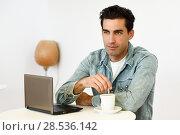 Купить «Good looking man wearing denim shirt sitting in a coffee bar. Blue eyes guy with casual clothes.», фото № 28536142, снято 17 ноября 2016 г. (c) Ingram Publishing / Фотобанк Лори
