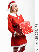 Купить «Blonde woman in Santa Claus clothes smiling with gift boxes in her hands. Young female with blue eyes, isolated on white», фото № 28536178, снято 23 августа 2017 г. (c) Ingram Publishing / Фотобанк Лори