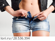 Купить «Beautiful woman body in denim jeans shorts and black leather jacket», фото № 28536394, снято 12 января 2016 г. (c) Ingram Publishing / Фотобанк Лори