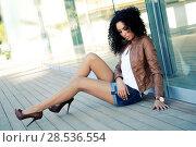 Купить «Portrait of a young black woman, model of fashion», фото № 28536554, снято 11 декабря 2011 г. (c) Ingram Publishing / Фотобанк Лори