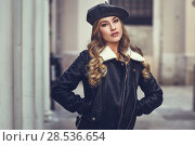 Купить «Blonde russian woman in urban background. Beautiful young girl wearing beret, black leather jacket and mini skirt standing in the street. Pretty female with long wavy hair hairstyle and blue eyes.», фото № 28536654, снято 24 января 2017 г. (c) Ingram Publishing / Фотобанк Лори