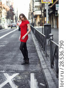 Купить «Young blonde woman standing in the street. Beautiful girl in urban background wearing red dress and black tights. Female with straight hair.», фото № 28536790, снято 11 декабря 2016 г. (c) Ingram Publishing / Фотобанк Лори