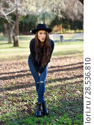 Купить «Woman smiling in urban park. Girl wearing casual clothes and hat.», фото № 28536810, снято 12 января 2016 г. (c) Ingram Publishing / Фотобанк Лори