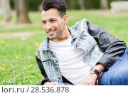 Portrait of a young handsome man, model of fashion, with modern hairstyle smiling in urban background. Стоковое фото, фотограф Javier Sánchez Mingorance / Ingram Publishing / Фотобанк Лори