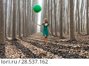 Купить «Beautiful blonde girl, dressed in green, walking into the forest», фото № 28537162, снято 4 декабря 2011 г. (c) Ingram Publishing / Фотобанк Лори