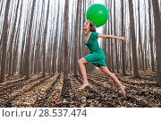 Купить «Beautiful blonde girl, dressed in green, jumping into the woods with a balloon in Fuente Vaqueros, Granada, Spain», фото № 28537474, снято 4 декабря 2011 г. (c) Ingram Publishing / Фотобанк Лори