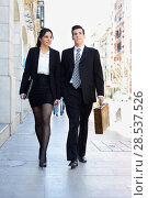 Купить «Portrait of an atractive business people walking on the street. Couple working.», фото № 28537526, снято 1 февраля 2013 г. (c) Ingram Publishing / Фотобанк Лори