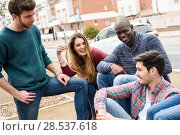 Group of multi-ethnic young people having fun together outdoors in urban background. Стоковое фото, фотограф Javier Sánchez Mingorance / Ingram Publishing / Фотобанк Лори