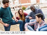 Купить «Group of multi-ethnic young people having fun together outdoors in urban background», фото № 28537618, снято 22 марта 2015 г. (c) Ingram Publishing / Фотобанк Лори