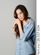 Купить «Young casual woman style over gray background. studio portrait female model. Beautiful smiling happy girl.», фото № 28537634, снято 18 мая 2013 г. (c) Ingram Publishing / Фотобанк Лори