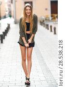 Купить «Portrait of happy blonde girl smiling in urban background», фото № 28538218, снято 15 ноября 2014 г. (c) Ingram Publishing / Фотобанк Лори