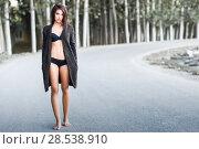 Купить «Portrait of woman in lingerie walking in a rural road», фото № 28538910, снято 25 октября 2014 г. (c) Ingram Publishing / Фотобанк Лори