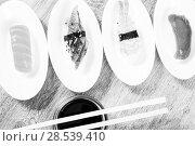 four kinds of Nigirisushi on oval saucers. Стоковое фото, фотограф Татьяна Яцевич / Фотобанк Лори