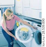 Купить «woman customer selecting new washer», фото № 28539890, снято 1 марта 2018 г. (c) Яков Филимонов / Фотобанк Лори