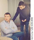 Купить «Man is offended and son is asking for his forgiveness», фото № 28539898, снято 5 февраля 2018 г. (c) Яков Филимонов / Фотобанк Лори