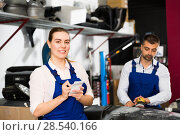 Купить «Girl mechanic taking notes on notebook», фото № 28540166, снято 4 апреля 2018 г. (c) Яков Филимонов / Фотобанк Лори