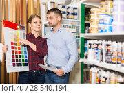 Купить «Two designer are looking sample of materials for repair», фото № 28540194, снято 16 февраля 2018 г. (c) Яков Филимонов / Фотобанк Лори