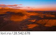 Купить «Red earth with iron oxides at sunset aerial view. Beautiful sunset. Martian landscape.», фото № 28542678, снято 25 сентября 2017 г. (c) Евгений Глазунов / Фотобанк Лори