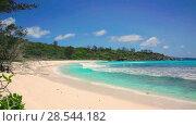 Купить «Small waves and white beach at Seychelles islands. La Digue, Anse Cocos», видеоролик № 28544182, снято 4 июня 2018 г. (c) Mikhail Starodubov / Фотобанк Лори