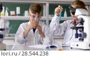 Купить «teacher and students studying chemistry at school», видеоролик № 28544238, снято 28 мая 2018 г. (c) Syda Productions / Фотобанк Лори