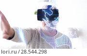 Купить «senior man in vr headset with earth projection», видеоролик № 28544298, снято 22 мая 2019 г. (c) Syda Productions / Фотобанк Лори