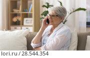 Купить «senior woman calling on smartphone at home», видеоролик № 28544354, снято 29 мая 2018 г. (c) Syda Productions / Фотобанк Лори