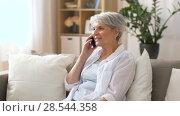 Купить «senior woman calling on smartphone at home», видеоролик № 28544358, снято 30 мая 2018 г. (c) Syda Productions / Фотобанк Лори