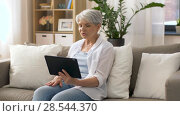 Купить «senior woman having video chat on tablet pc», видеоролик № 28544370, снято 29 мая 2018 г. (c) Syda Productions / Фотобанк Лори