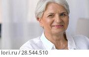 Купить «portrait of happy senior woman laughing», видеоролик № 28544510, снято 29 мая 2018 г. (c) Syda Productions / Фотобанк Лори