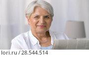 Купить «portrait of senior woman reading newspaper at home», видеоролик № 28544514, снято 29 мая 2018 г. (c) Syda Productions / Фотобанк Лори