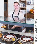 Купить «portrait of young woman baker with tasty cakes and rolls», фото № 28544662, снято 22 апреля 2017 г. (c) Яков Филимонов / Фотобанк Лори
