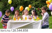 Купить «happy kids on birthday party at summer garden», видеоролик № 28544858, снято 5 июня 2018 г. (c) Syda Productions / Фотобанк Лори