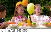 Купить «kids giving presents to birthday child at party», видеоролик № 28545050, снято 5 июня 2018 г. (c) Syda Productions / Фотобанк Лори