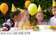 Купить «happy kids on birthday party at summer garden», видеоролик № 28545078, снято 5 июня 2018 г. (c) Syda Productions / Фотобанк Лори