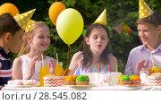 Купить «happy kids on birthday party at summer garden», видеоролик № 28545082, снято 5 июня 2018 г. (c) Syda Productions / Фотобанк Лори