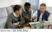 Купить «Cheerful male friends using laptop during bachelor gathering at home», видеоролик № 28546842, снято 11 марта 2018 г. (c) Яков Филимонов / Фотобанк Лори