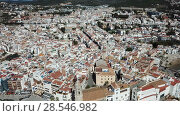 Купить «Aerial view of Sitges small town with church on Mediterranean coastline, Spain», видеоролик № 28546982, снято 27 апреля 2018 г. (c) Яков Филимонов / Фотобанк Лори