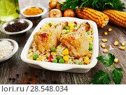 Купить «Chicken legs baked with rice and vegetables», фото № 28548034, снято 5 марта 2018 г. (c) Надежда Мишкова / Фотобанк Лори