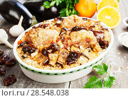 Купить «Chicken thigh baked with rice, eggplant and figs», фото № 28548038, снято 9 марта 2018 г. (c) Надежда Мишкова / Фотобанк Лори