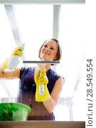 Купить «Young woman cleaning a window», фото № 28549554, снято 27 мая 2020 г. (c) age Fotostock / Фотобанк Лори