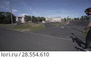 Купить «Electric Longboard summer ride on red sport stadium with playground», видеоролик № 28554610, снято 9 июня 2018 г. (c) Aleksejs Bergmanis / Фотобанк Лори