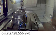Купить «The robot manipulator arm places the metal part in the lathe chuck of the CNC machine», видеоролик № 28556970, снято 28 мая 2018 г. (c) Андрей Радченко / Фотобанк Лори