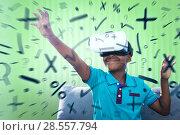 Купить «Composite image of smiling boy using virtual reality simulator», фото № 28557794, снято 16 февраля 2019 г. (c) Wavebreak Media / Фотобанк Лори