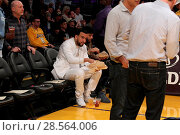 Купить «Celebrities at the Lakers game. The Los Angeles Lakers defeated the Golden State Warriors by the final score of 117-97 at Staples Center in downtown Los...», фото № 28564006, снято 4 ноября 2016 г. (c) age Fotostock / Фотобанк Лори